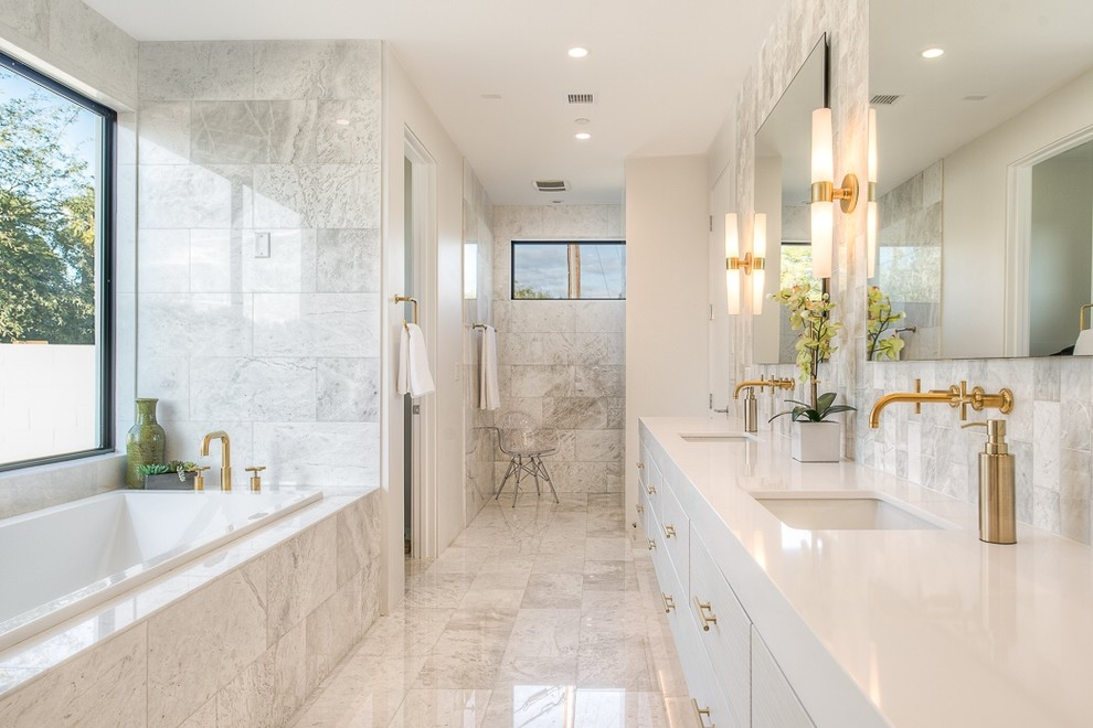 Example of a mid-sized trendy master stone tile and white tile marble floor bathroom design in Phoenix with an undermount sink, flat-panel cabinets, quartz countertops and white cabinets