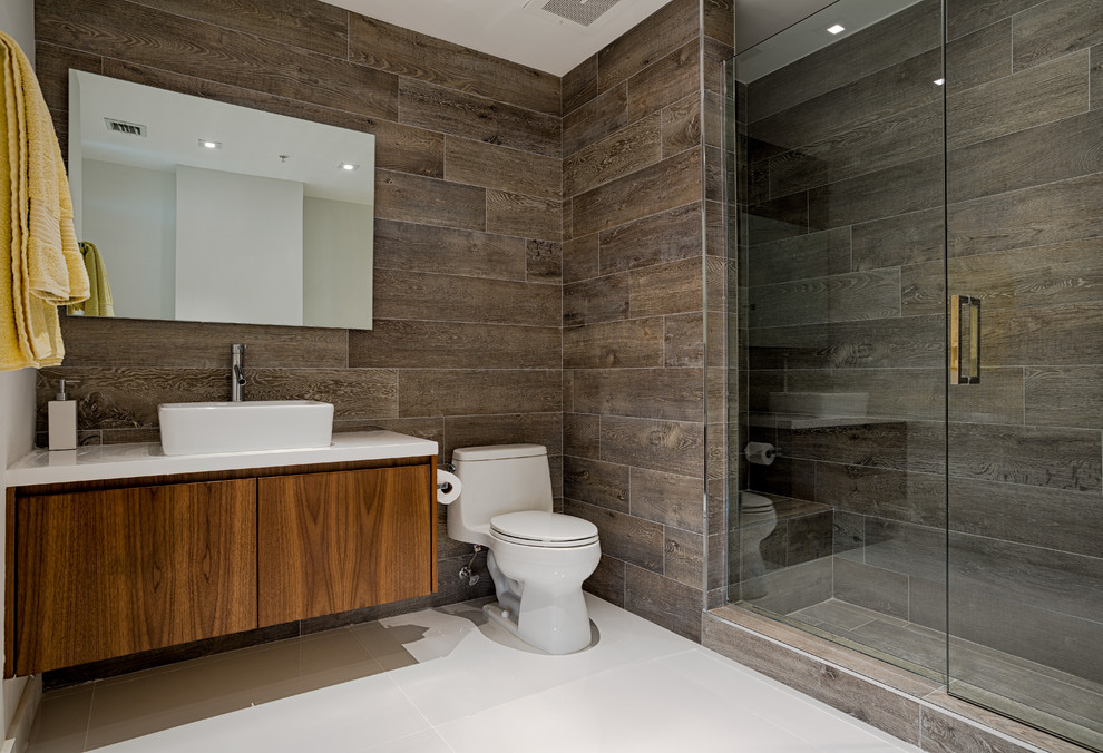 Inspiration for a contemporary alcove shower remodel in Miami with a vessel sink, flat-panel cabinets, dark wood cabinets and a one-piece toilet