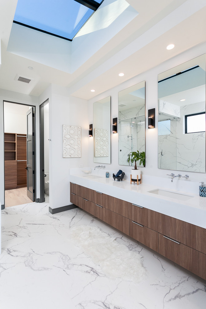 Inspiration for a contemporary master white floor bathroom remodel in Orange County with flat-panel cabinets, dark wood cabinets, white walls, an undermount sink and white countertops