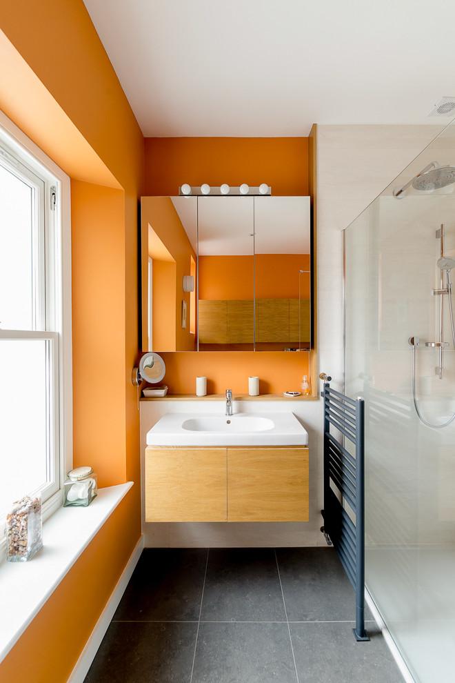 Trendy gray floor bathroom photo in Other with orange walls