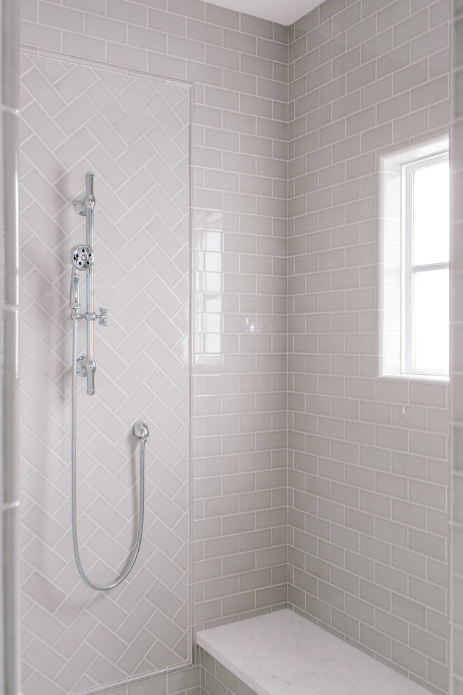 Inspiration for a cottage master gray tile and subway tile marble floor freestanding bathtub remodel in Phoenix with a one-piece toilet, gray walls, an undermount sink and marble countertops