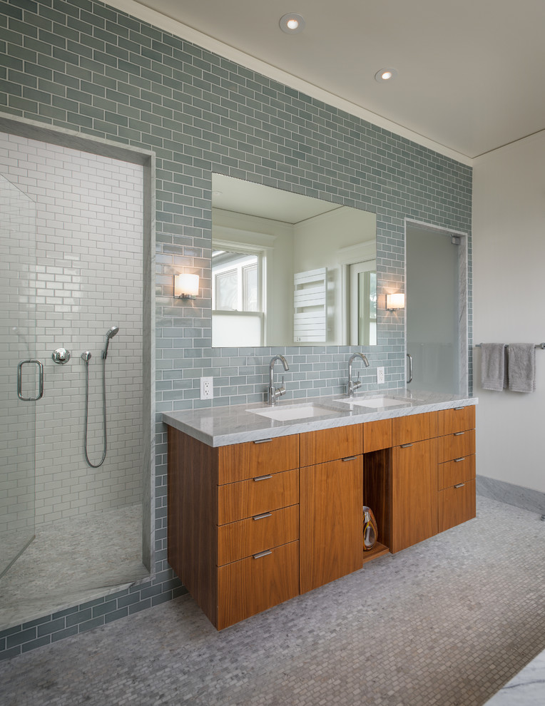 Trendy gray tile and subway tile alcove shower photo in San Francisco with an undermount sink, flat-panel cabinets, medium tone wood cabinets and gray countertops