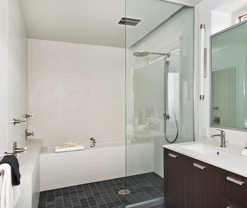 Example of a mid-sized minimalist white tile bathroom design in San Francisco with flat-panel cabinets, dark wood cabinets, white walls and an undermount sink