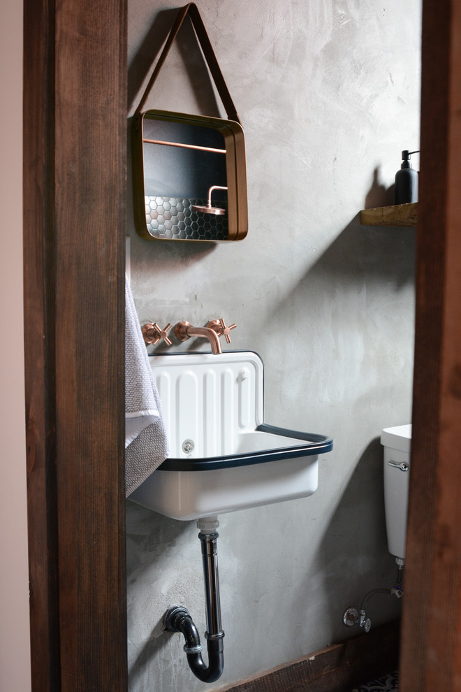 Inspiration for an industrial bathroom remodel in New Orleans with open cabinets, medium tone wood cabinets, gray walls and a wall-mount sink