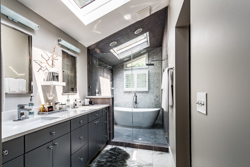 Wet room with shower and freestanding tub