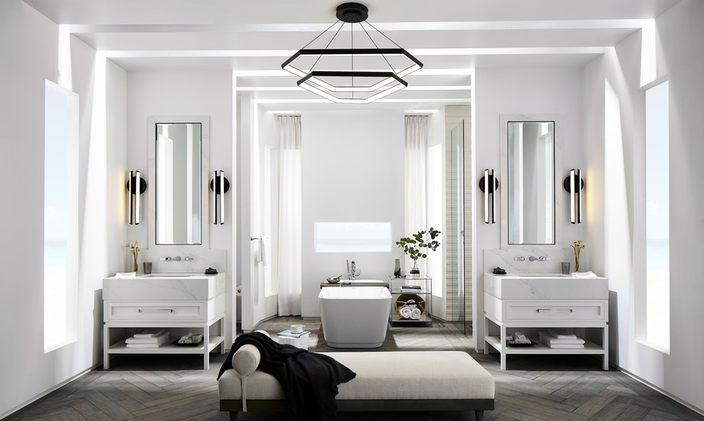 Bathroom - large contemporary master white tile and porcelain tile medium tone wood floor and gray floor bathroom idea in Los Angeles with shaker cabinets, white cabinets, a wall-mount toilet, white walls, an undermount sink, solid surface countertops and white countertops