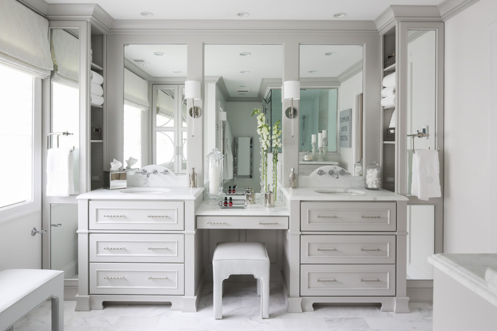 Bathroom - large traditional master white tile and stone tile marble floor bathroom idea in New York with flat-panel cabinets, gray cabinets, a two-piece toilet, gray walls, an undermount sink and marble countertops