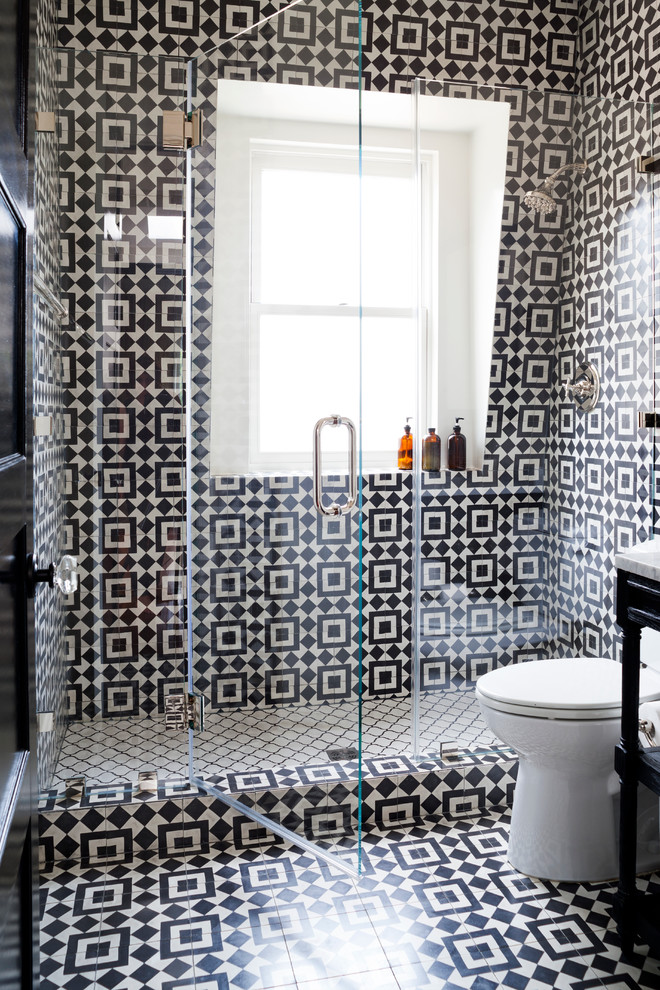 Mid-sized trendy black and white tile alcove shower photo in DC Metro with a two-piece toilet