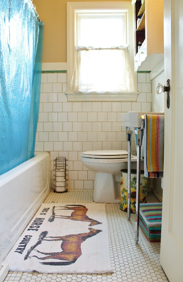 Bathroom - eclectic white tile and ceramic tile ceramic tile bathroom idea in Seattle with a wall-mount sink and yellow walls