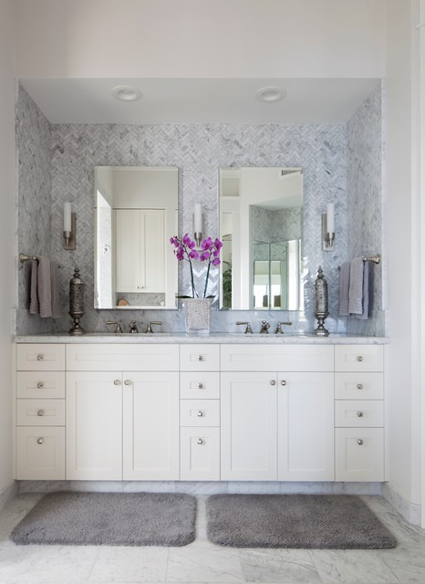 Example of an island style white tile and stone tile bathroom design in Hawaii with white cabinets