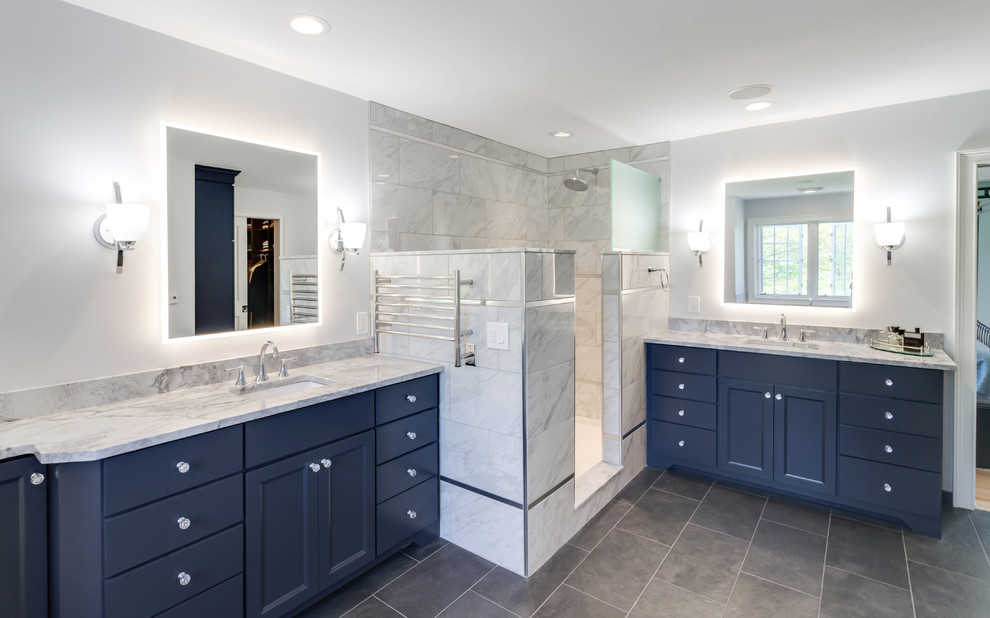 Inspiration for a large transitional master gray tile and porcelain tile porcelain tile and gray floor bathroom remodel in Philadelphia with flat-panel cabinets, blue cabinets, a two-piece toilet, gray walls, an undermount sink, granite countertops and gray countertops
