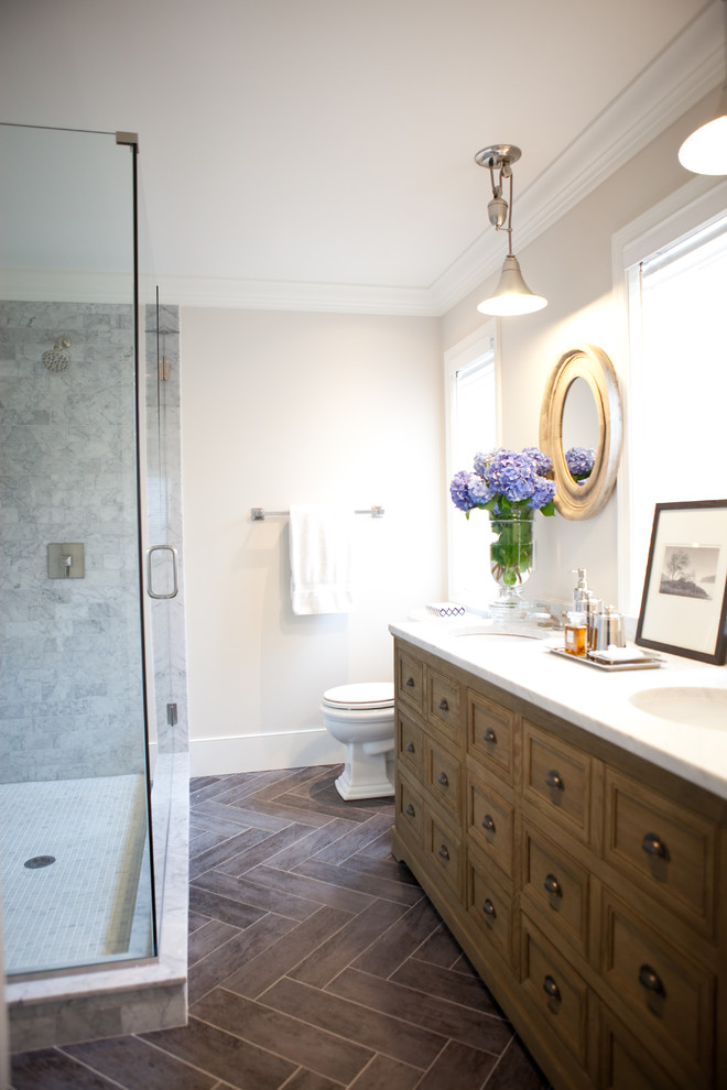 Inspiration for a transitional bathroom remodel in Baltimore with dark wood cabinets