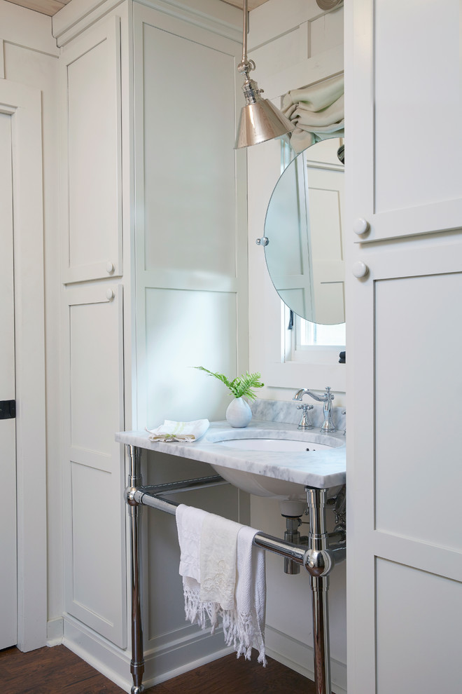 Bathroom - small cottage dark wood floor and brown floor bathroom idea in Birmingham with shaker cabinets, white cabinets, white walls and an undermount sink