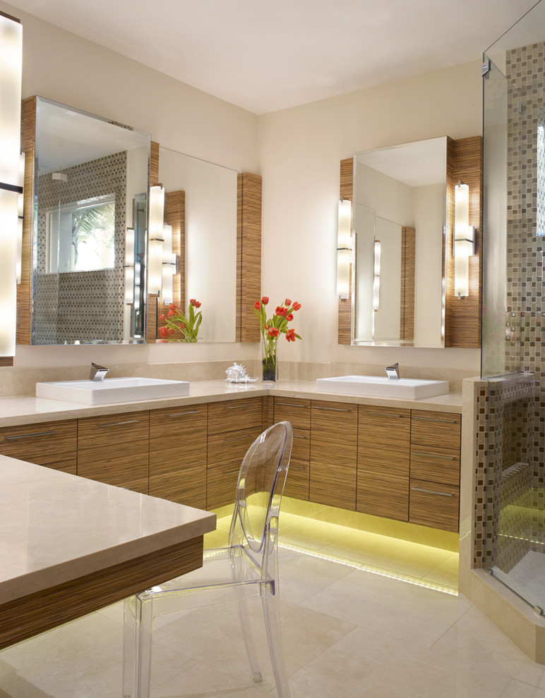 Corner shower - large contemporary master marble floor corner shower idea in Miami with a vessel sink, flat-panel cabinets and medium tone wood cabinets