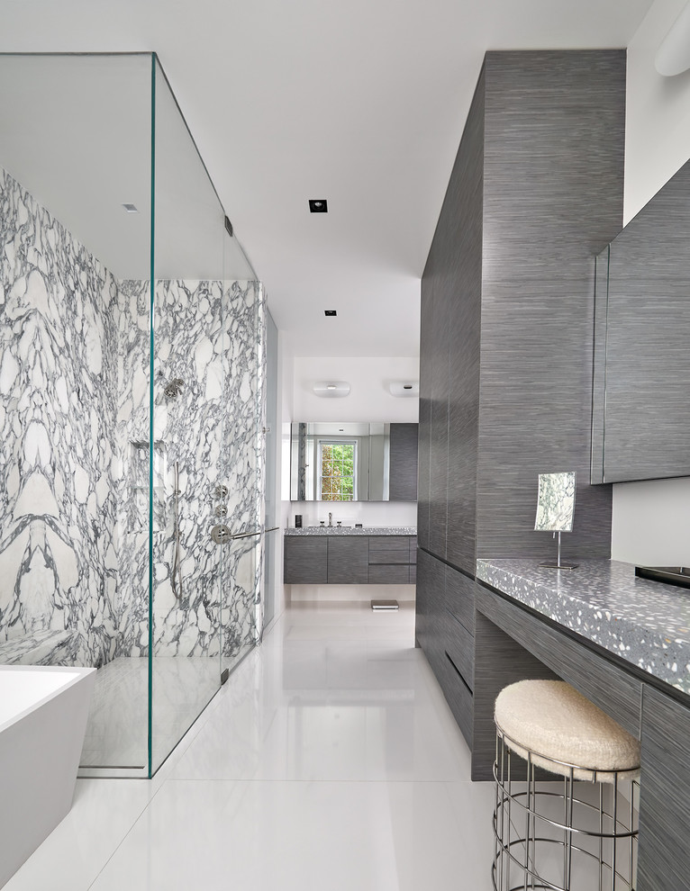 Trendy black and white tile and stone slab white floor bathroom photo in DC Metro with concrete countertops, flat-panel cabinets, gray cabinets, white walls, a hinged shower door and gray countertops
