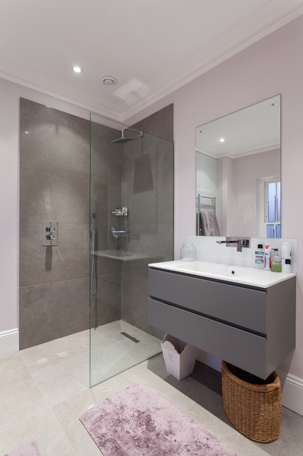 This is an example of a contemporary bathroom in London with an integrated sink, flat-panel cabinets, grey cabinets, a walk-in shower, grey tiles, purple walls and an open shower.