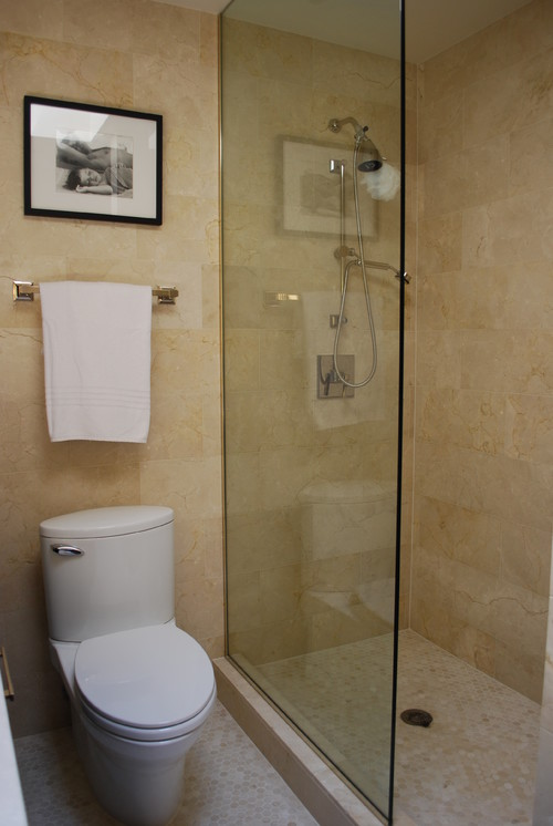 Is that a half shower glass or is the other half(door) hidden on this photo?