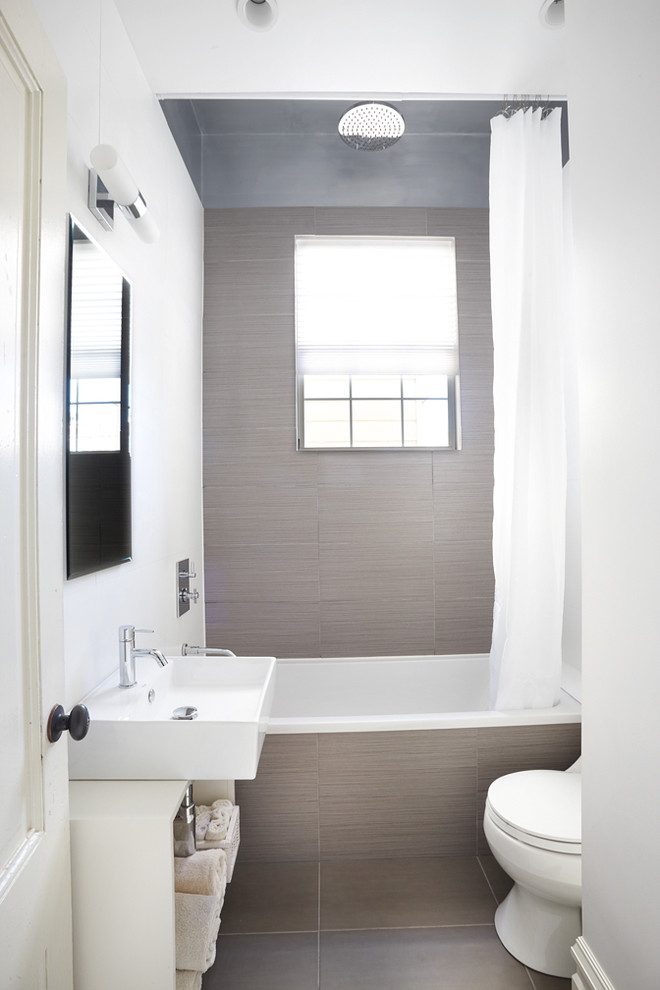 Bathroom - contemporary brown tile bathroom idea in San Francisco with a vessel sink and open cabinets