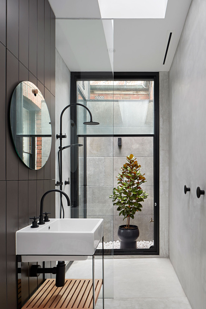 Inspiration for a contemporary 3/4 black tile white floor bathroom remodel in Sydney with open cabinets, an integrated sink and white countertops