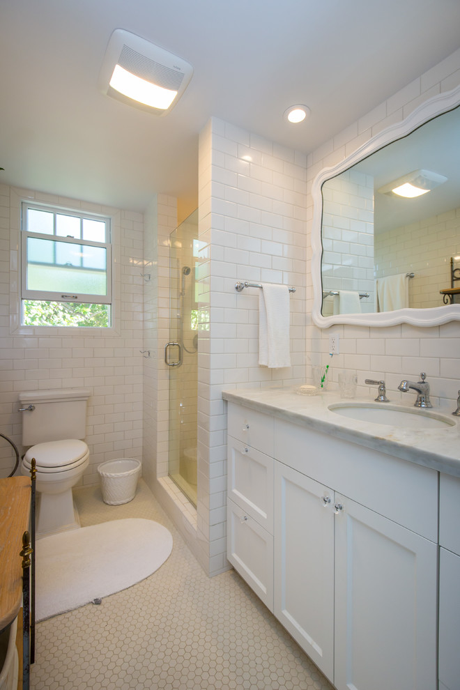 Elegant white tile bathroom photo in Hawaii with a pedestal sink, a one-piece toilet and white walls