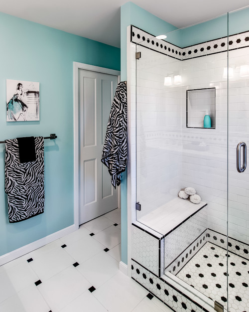 black and white bathroom with zebra towels and black spot tiles