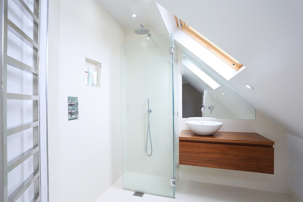 Trendy corner shower photo in London with a vessel sink, flat-panel cabinets, medium tone wood cabinets, wood countertops, white walls and brown countertops