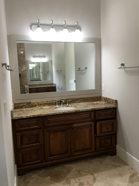 Bathroom - large transitional bathroom idea in Atlanta with raised-panel cabinets, dark wood cabinets and granite countertops
