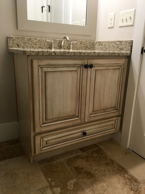 Inspiration for a mid-sized transitional 3/4 bathroom remodel in Atlanta with raised-panel cabinets, distressed cabinets and an undermount sink