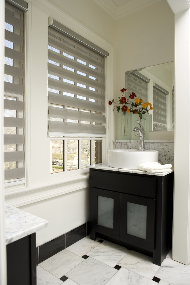 Bathroom - small contemporary 3/4 black and white tile and marble tile marble floor and white floor bathroom idea in Miami with glass-front cabinets, black cabinets, a one-piece toilet, white walls, a vessel sink and marble countertops