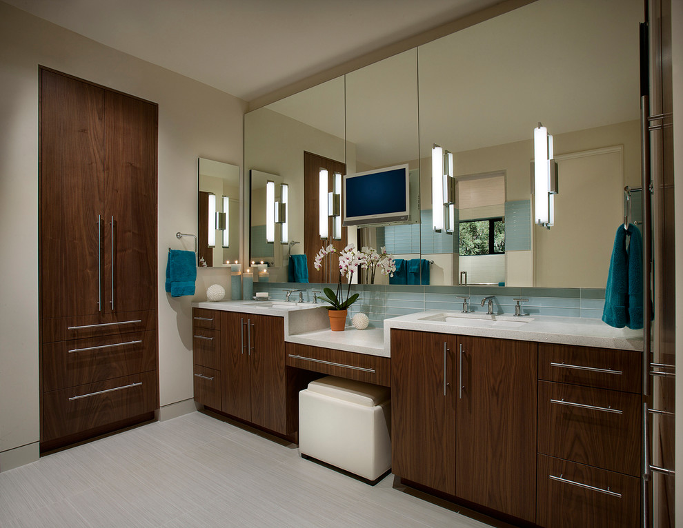 Bathroom - contemporary blue tile bathroom idea in Phoenix with an undermount sink, flat-panel cabinets and dark wood cabinets