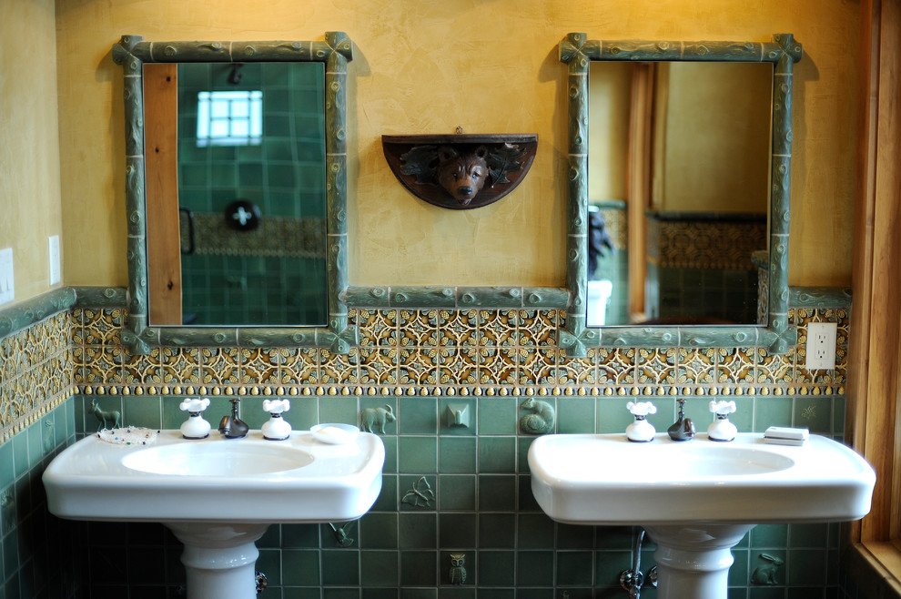 Example of a mountain style bathroom design in Phoenix with a pedestal sink