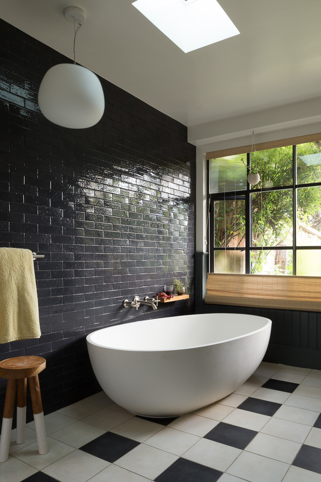 Design ideas for a mid-sized eclectic master bathroom in San Francisco with a freestanding tub, black tile, subway tile, an alcove shower, white walls and porcelain floors.