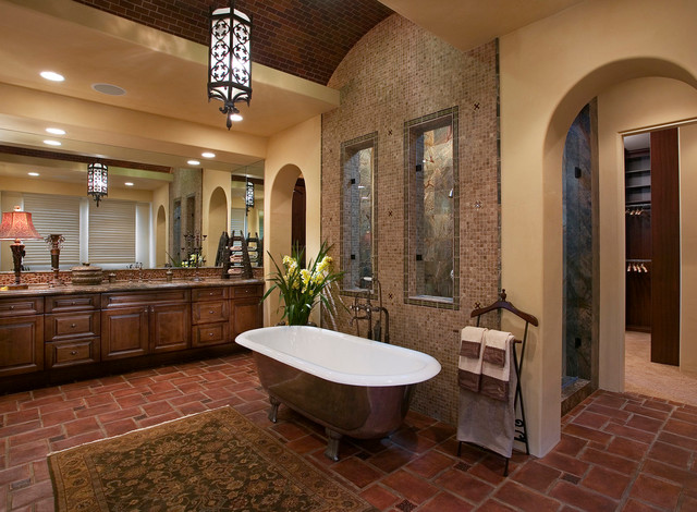 Example of a tuscan mosaic tile terra-cotta floor freestanding bathtub design in Orange County