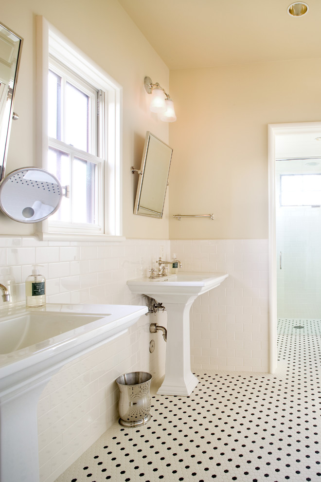 Bathroom - large traditional master mosaic tile and white tile mosaic tile floor bathroom idea in Austin with a pedestal sink and yellow walls