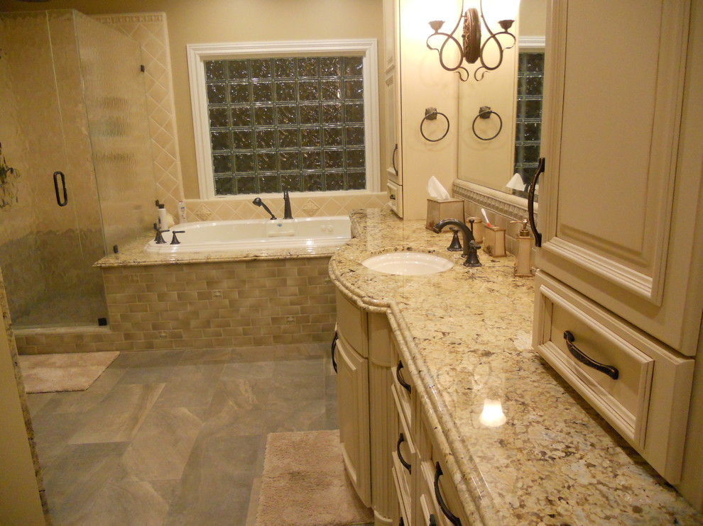 Example of a large classic master beige tile and ceramic tile slate floor and gray floor bathroom design in San Francisco with raised-panel cabinets, beige cabinets, a two-piece toilet, beige walls, an undermount sink, granite countertops, a hinged shower door and beige countertops