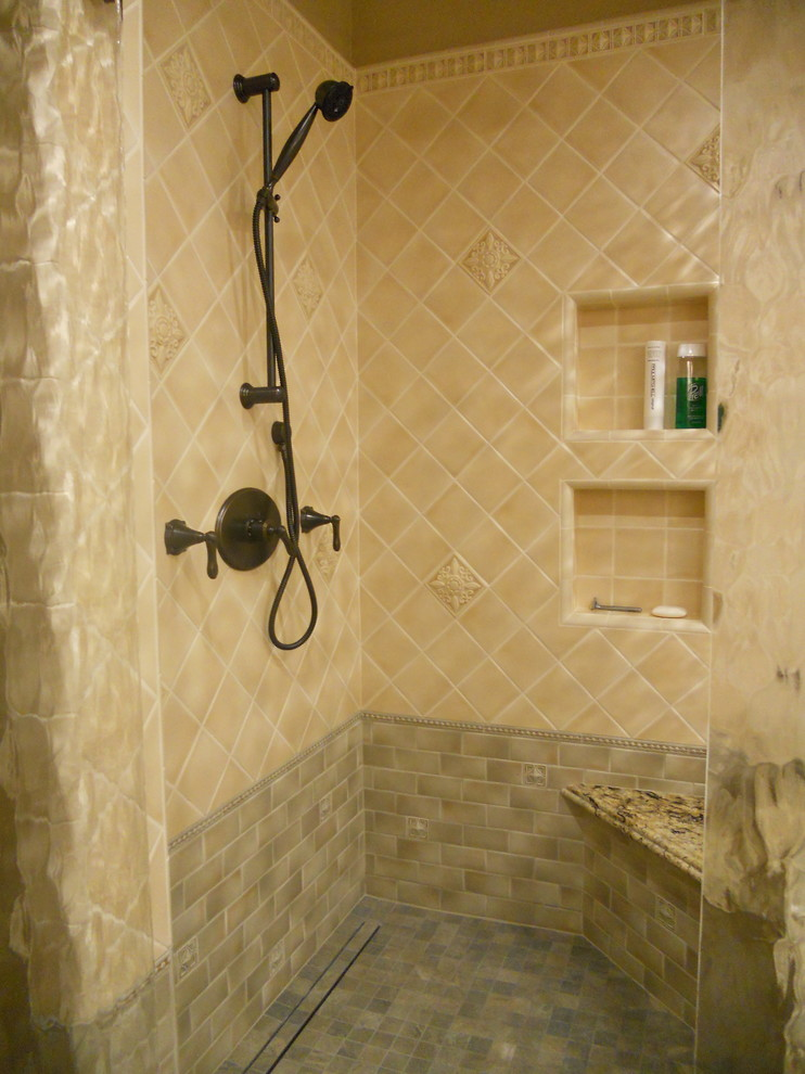 Bathroom - large traditional master beige tile and ceramic tile slate floor and gray floor bathroom idea in San Francisco with raised-panel cabinets, beige cabinets, a two-piece toilet, beige walls, an undermount sink, granite countertops, a hinged shower door and beige countertops