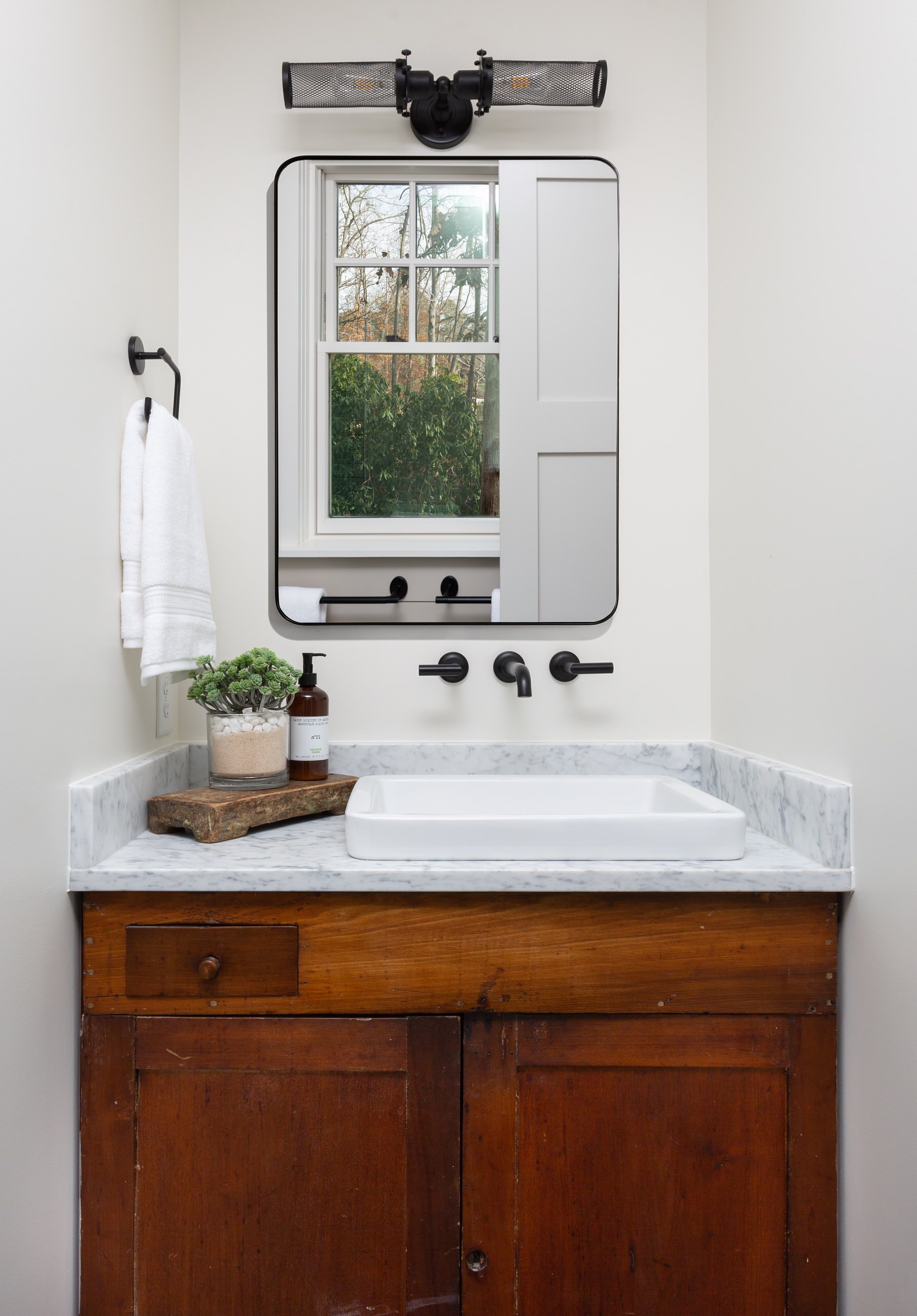 Antique cabinet repurposed to use as the vanity in the master bathroom