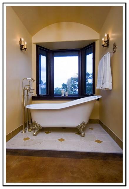 Antique clawfoot bath mediterranean bathroom for Bathroom builders birmingham