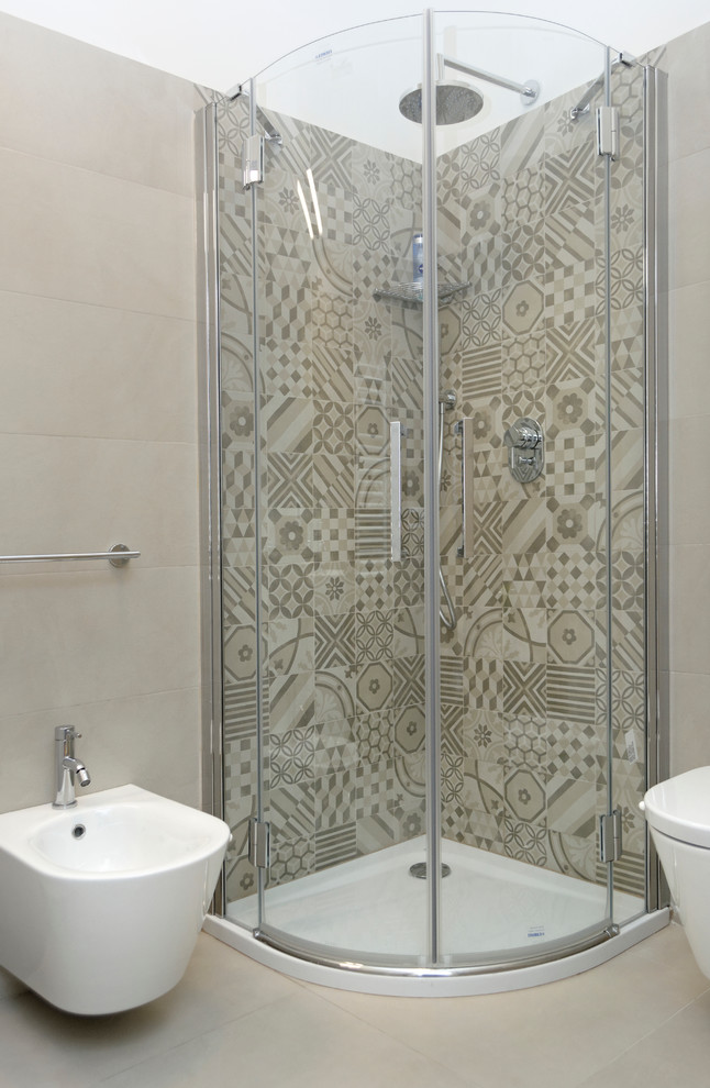 Corner shower - small contemporary master beige tile and ceramic tile ceramic tile corner shower idea in Milan with a wall-mount toilet and white walls