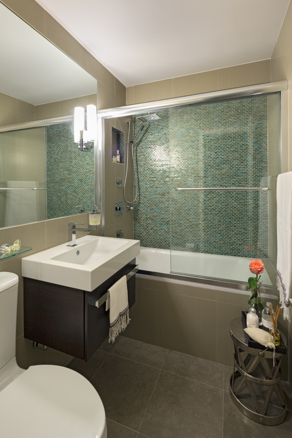 Example of a mid-sized minimalist master blue tile, green tile and glass tile bathroom design in New York with flat-panel cabinets, dark wood cabinets, a one-piece toilet and a wall-mount sink