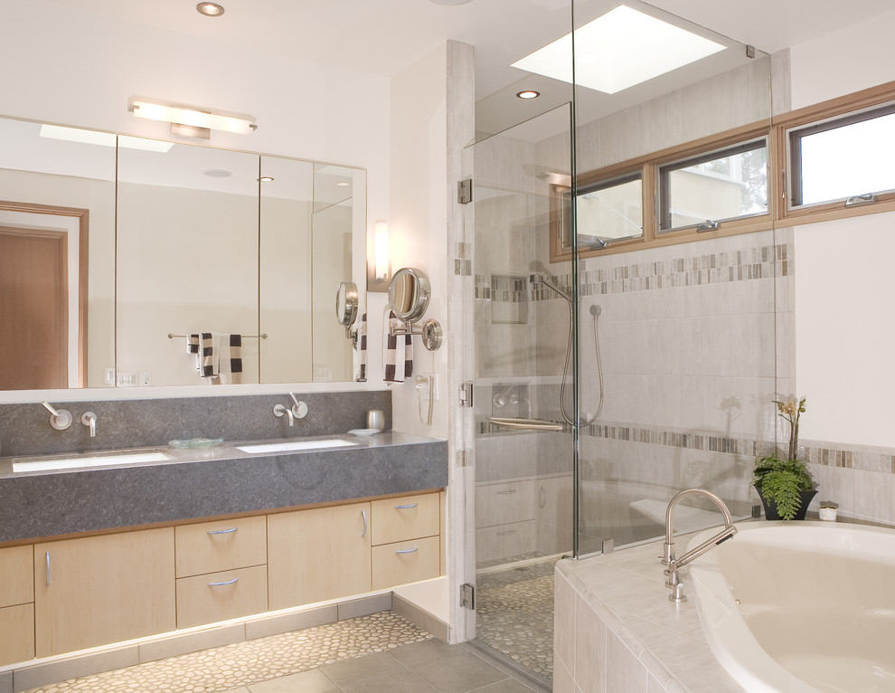 Trendy beige tile pebble tile floor bathroom photo in San Francisco with an undermount sink, flat-panel cabinets and light wood cabinets