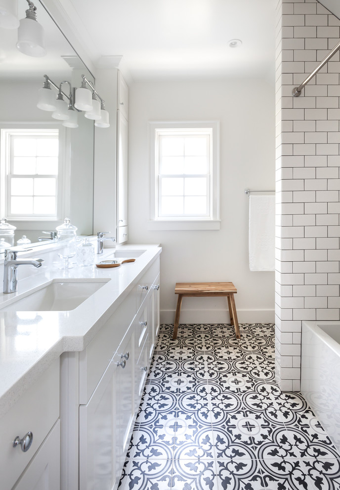 Example of a mid-sized black and white tile and cement tile bathroom design in Sacramento with white walls and engineered quartz countertops