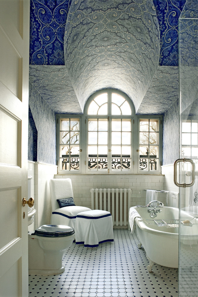 Example of a classic subway tile claw-foot bathtub design in Philadelphia