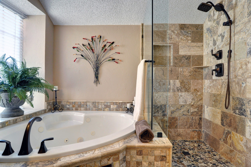 Inspiration for a timeless beige tile and stone tile bathroom remodel in Dallas with recessed-panel cabinets, dark wood cabinets and beige walls