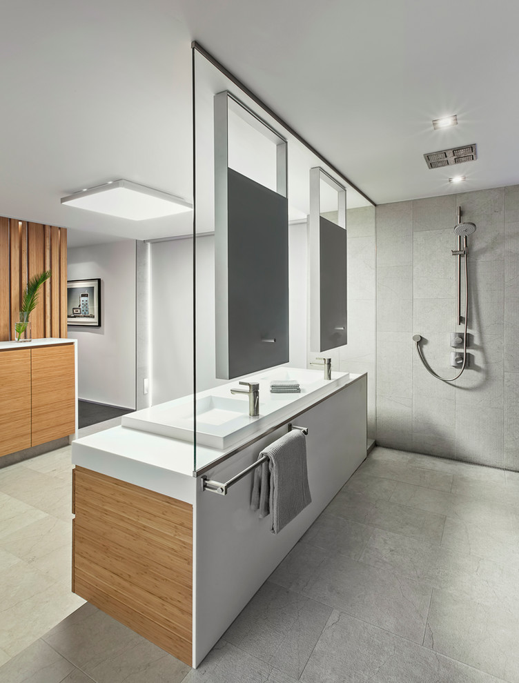 Inspiration for a contemporary gray tile alcove shower remodel in Toronto with a vessel sink, flat-panel cabinets and medium tone wood cabinets