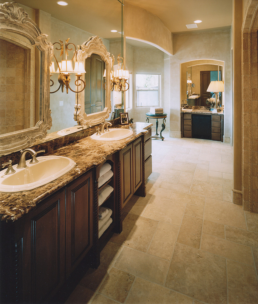 Bathroom - traditional beige tile beige floor bathroom idea in Phoenix with a drop-in sink, dark wood cabinets and raised-panel cabinets