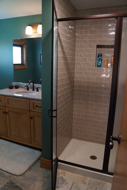 Small arts and crafts gray tile and ceramic tile ceramic floor bathroom photo in Indianapolis with an undermount sink, shaker cabinets, light wood cabinets, engineered quartz countertops and blue walls
