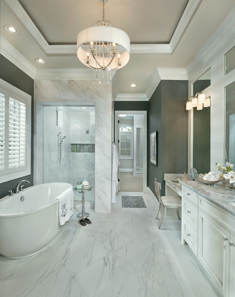 Bathroom - large transitional master white tile and porcelain tile porcelain floor and white floor bathroom idea in Cincinnati with an undermount sink, recessed-panel cabinets, white cabinets, marble countertops and gray walls