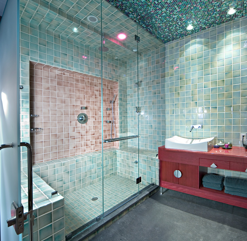 Example of a large eclectic ceramic tile and green tile concrete floor sauna design in New York with flat-panel cabinets, red cabinets, wood countertops, green walls and red countertops