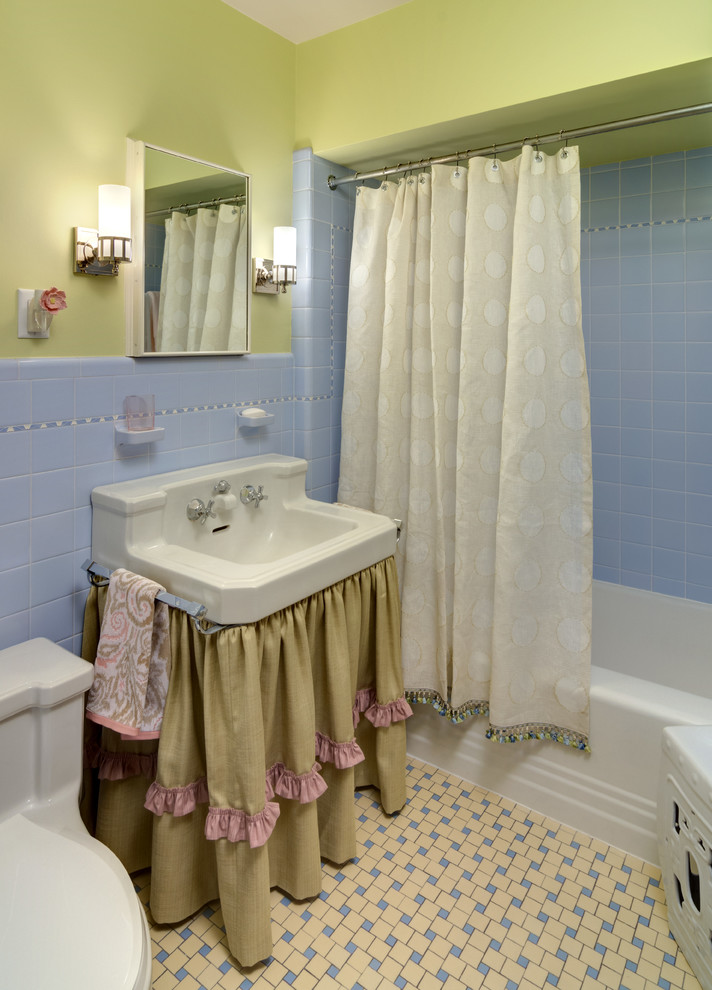 Bathroom - small traditional kids' ceramic tile and blue tile ceramic tile and yellow floor bathroom idea in Minneapolis with green walls and a console sink